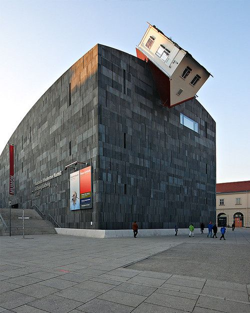 Erwin Wurm: House Attack, 2006. Outdoor sculpture at the Museum Moderner Kunst